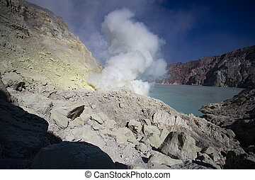 Sulfur mine with workers in Kawah Ijen, Java, Indonesia