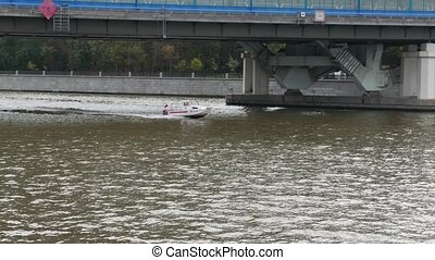 boat on Moskva River and the administrative and residential...