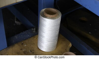 yarn spools on spinning machine in a factory - Textile...