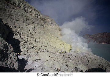 Sulfur mine with workers in Kawah Ijen, Java, Indonesia