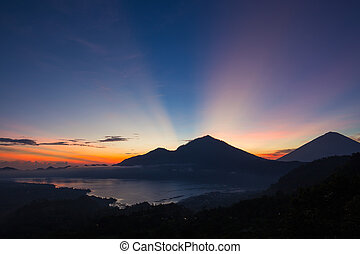 Volcano and lake Batur at sunrise time, Bali, Indonesia -...