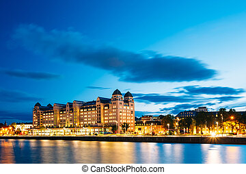 Summer evening view of the house on the citys waterfront,...