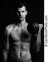 Handsome young muscular man lifting weights over dark background