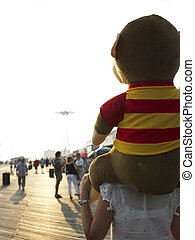 Stuffed Animal on Woman\'s Shoulders - Rear view of a female...