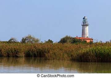 Lighthouse from Po river lagoon - View of a lighthouse...