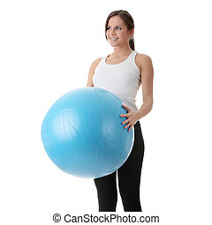 Young happy woman doing fitness exercise