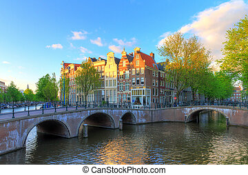 Canal Amsterdam spring sunset - Beautiful sunset at the...