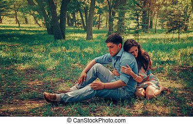 Couple in love sitting in summer park