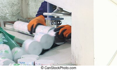 Worker cutting toilet paper