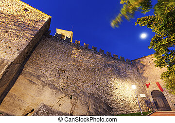 San Marino fortifications with full moon evening time