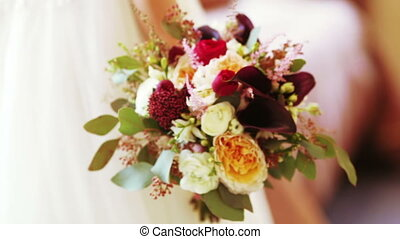 Wedding bridal bouquet - Hands bride holding wedding bouquet...