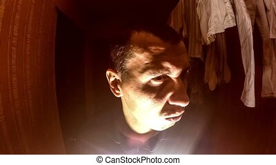 suspicious man maniac in the room below the hall light -...