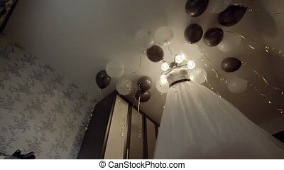 wedding dress hanging on the chandelier