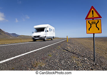Motor Home Driving On An Open Road With Danger Sign - Motion...