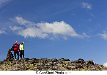 Romantic Couple Hiking Standing Pointing By Stone Pile Tor -...
