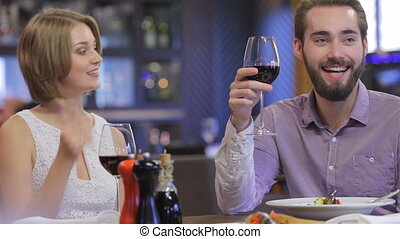 Collaborative romantic dinner in a restaurant