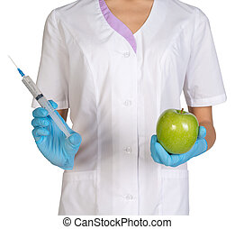 Medical worker holding a syringe injection and green apples.