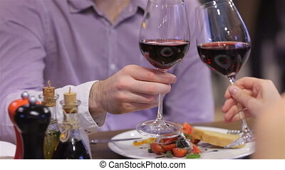 Couple toasting wine glasses Celebrating a Valentines Day at...