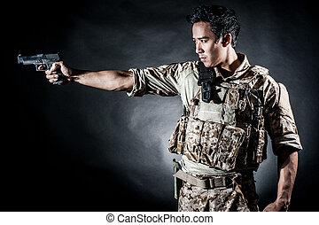 soldier man hold gun fashion