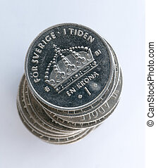 Swedish One Coins Stacked with a white background close up...