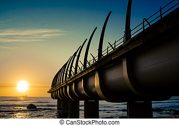 Umhlanga Pier In Durban South Africa with Sunrise over...