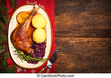 Crusty goose leg with braised red cabbage and dumplings....