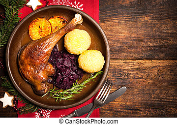 Crusty goose leg with braised red cabbage and dumplings...