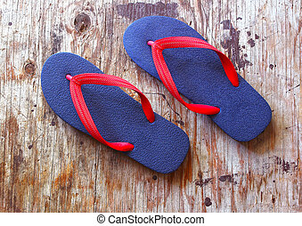 flip flop sandals on wood background : HDR toning