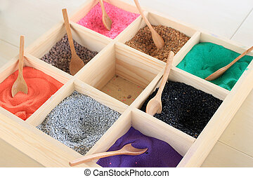 Colourful sands in wood box