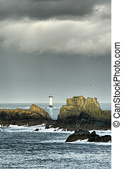 Before the storm, portrait - Lonely lighthouse in the...