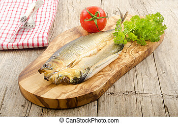 smoked kipper with tomato and parsley