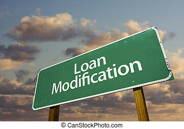 Loan Modification Green Road Sign with dramatic clouds and...