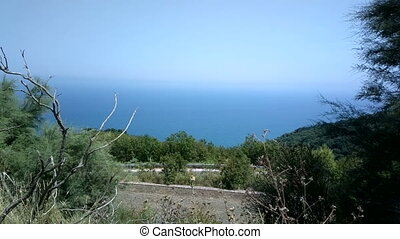 Sea views with high mountains with grass and trees - Sea...