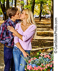 Couple with big basket of flowers in the park - Yuong couple...