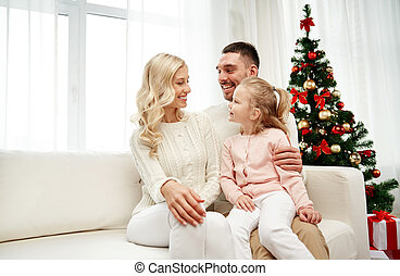 happy family at home with christmas tree