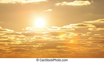 The sun in the clouds at sunset - The sun floating in the...