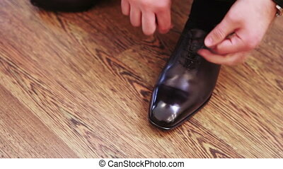 Close-up black shoes dressing - Man comes and puts expensive...