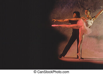 Duet with male and female ballet dancers with dramatic...