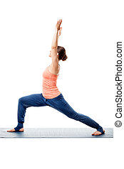 Sporty woman practices yoga asana - Beautiful sporty fit...