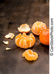Clementines as a whole and as pieces to a background - Fresh...