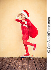 Funny kid with Santa bag - Child riding skateboard. Funny...