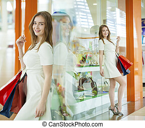Shopping, young beautiful women on the background showcases...