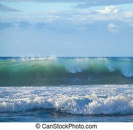 breaking waves - powerful ocean waves breaking by the shores...