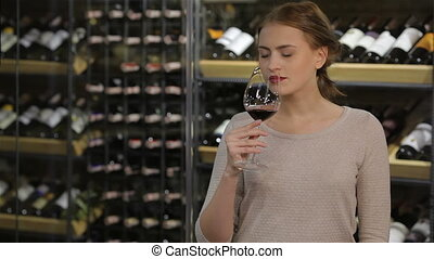 Attractive woman testing wine in the glass Sale, shopping,...