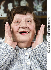 Grandma make a surprised face - Portrait of grandma making a...