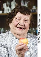 Health senior woman with fruit - Health senior woman sitting...