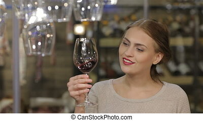 Beautiful young woman drinking wine - Woman drinking wine...