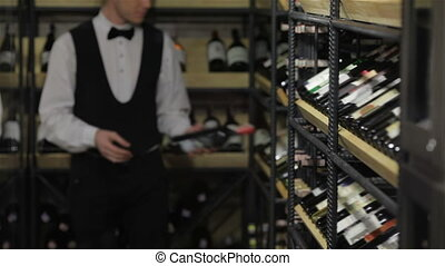 Close up face confident sommelier Thoughtful young sommelier...