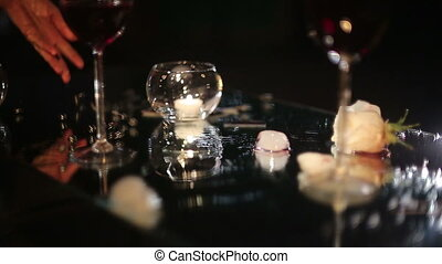 Evening Still Life - Black beads dropped on a glass table...