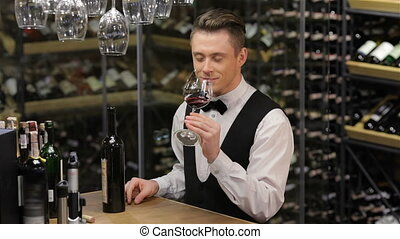 Confident and experienced sommelier Confident young man in...